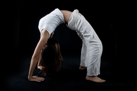 asian yoga girl with isolated black background  Stock Photo - 8754958