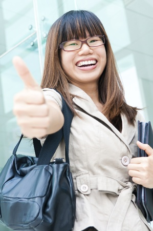 asian business women: asian business women smiling with hand thumbs p  Stock Photo
