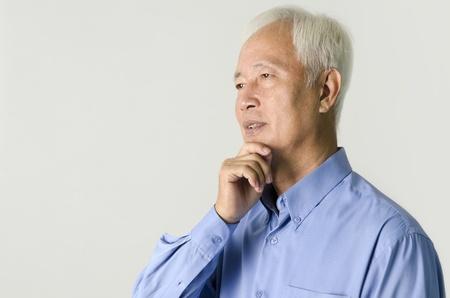 bald men: senior asian business man thinking