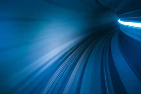 light trails: motion blur of movement in tunnel