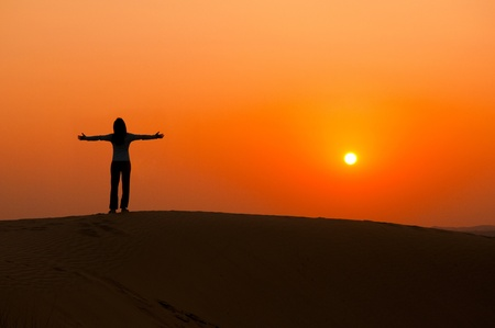 silhouette of a freedom girl on thar sam sand dune desert  photo