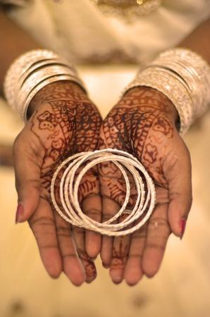 Indian wedding bride getting henna applied  photo
