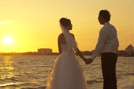asian wedding couple holding hands on valentines day photo