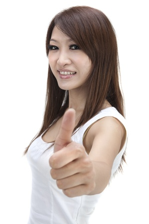 asian girl giving thumbs up photo