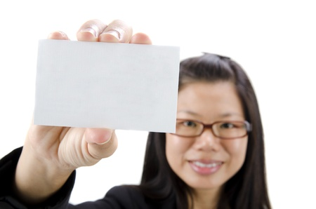 Asian businesswoman holding a blank business card and smiling at the camera  photo