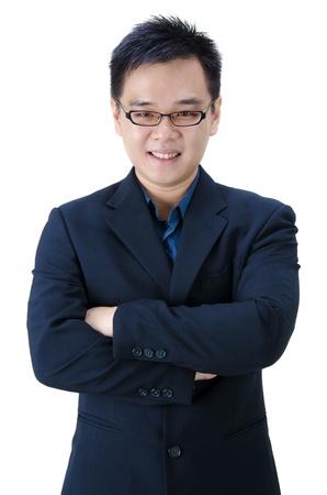 mani incrociate: uomo d'affari asiatico con le mani incrociate