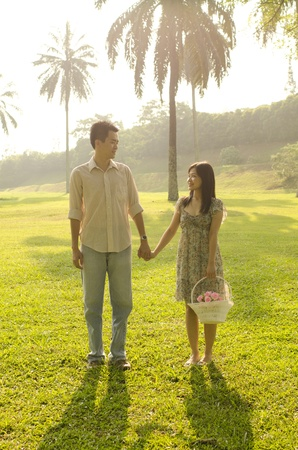 asian outdoor couple during a beautiful sunset Stock Photo - 9626945