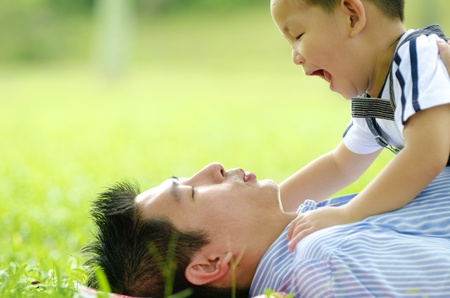 asian family playing on outdoor  photo