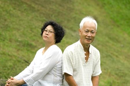asian senior couple outdoor portrait photo