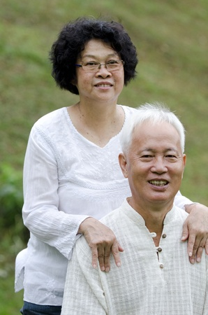 asian senior couple with green background