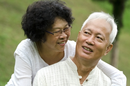 asian senior couple with green natural background photo