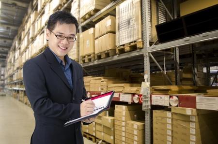 asian man inside a factory photo