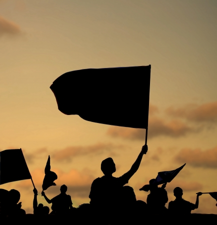 riot: silhouette of street protestors with flags and banners Stock Photo