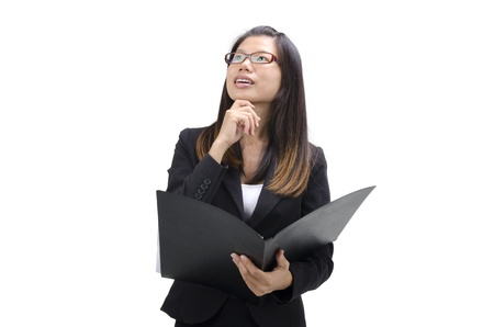Young women holding file standing having thought.  photo