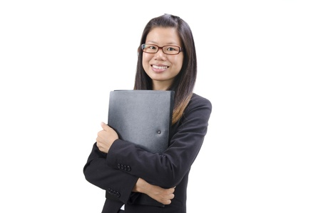 Young Business Women holding file standing on white background  photo