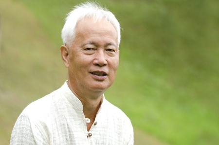 1 mature man: Senior asian man outdoor portrait