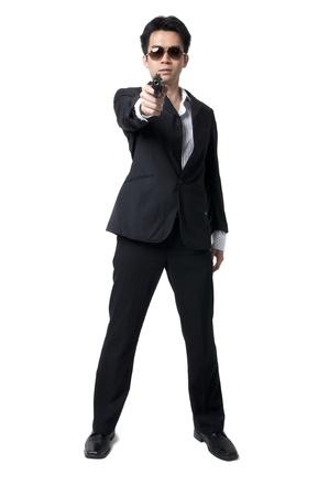 profesional: asian profesional gunman Stock Photo