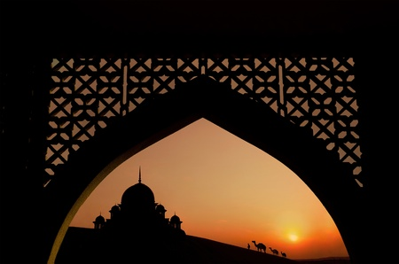 islamic scenery: silhouette of arabic architecture  on desert