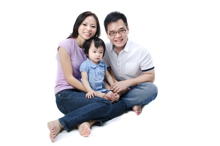 Happy Asian family on white background  Stock Photo - 10361204