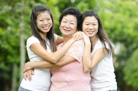 adult offspring: Happy Asian Senior lady and her daughters