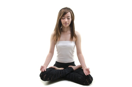 alternative looking asian girl performing yoga with white background Stock Photo - 11053458