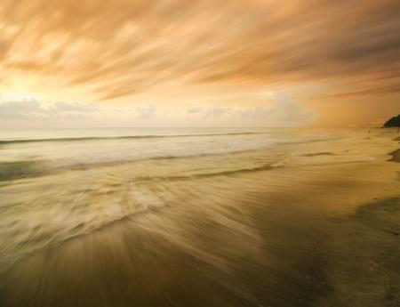 fast moving clouds on beach sunset Reklamní fotografie