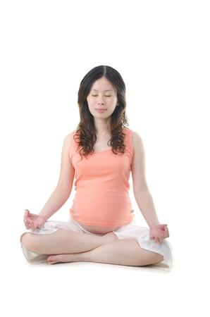 pregnancy yoga: asian pregnant mother Stock Photo