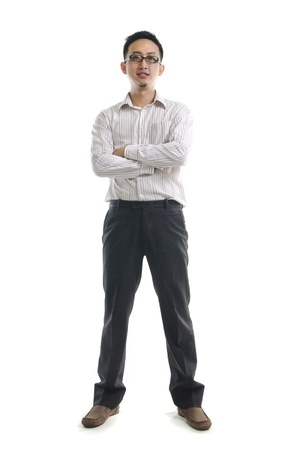 Full length of young Asian business man stand on white background.  photo