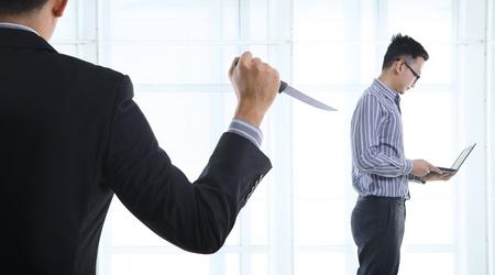 betray: pol�tica de la oficina, pu�alada por la espalda Foto de archivo
