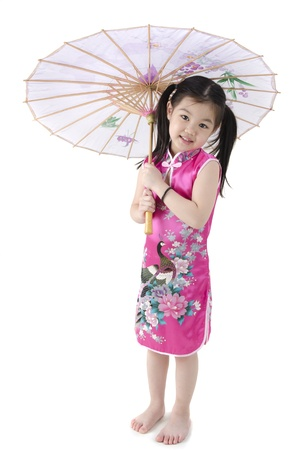 Little oriental girl in traditional Chinese dress cheongsam with umbrell Stock Photo - 12648826