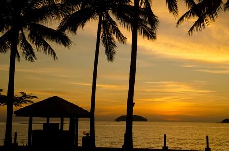hut on a beach sunset photo