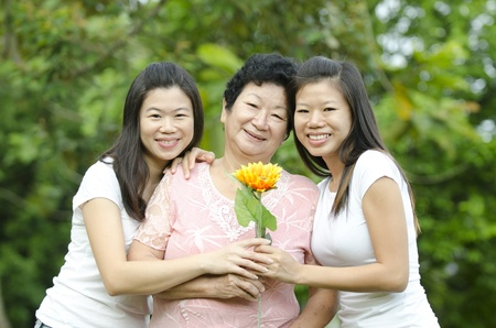 asian mother with two of her daughters photo