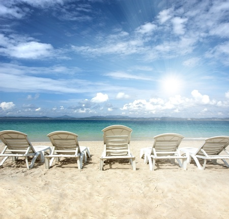 chairs on beach with blue sky for summer holiday  photo