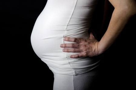 Pregnancy woman on black background Stock Photo - 13117471