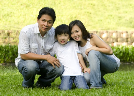 asian family with green background Stock Photo - 13117478