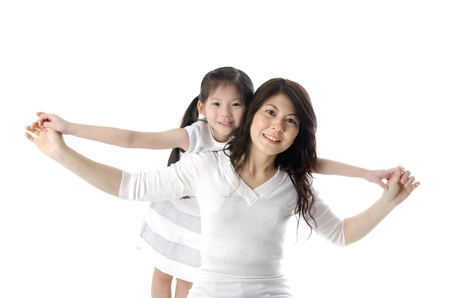 Asian mother having fun time with daughter