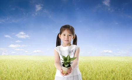 ni�os reciclando: asi�tico planta hembra celebraci�n concepto de la foto