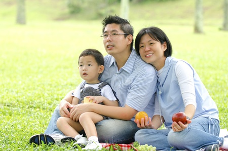 asian family having a picnic during outdoor ,focus on baby  photo