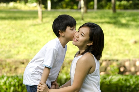 son kissing mother for mothers day photo