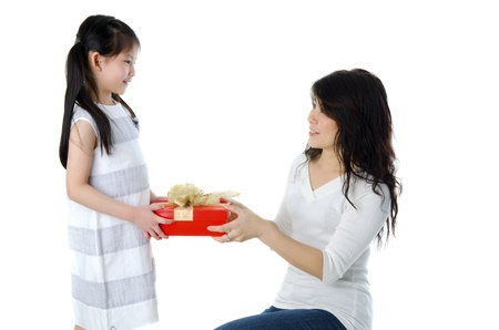 wrapped present: Little Asian girl arms out holding a beautiful wrapped present.  Stock Photo