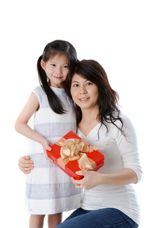 Little Asian girl giving gift for mother  photo