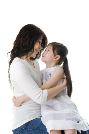 daugther: mother and daugther sitting on lap, perfect for mothers day