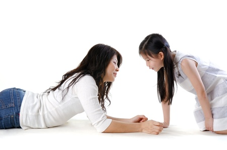 Asian mother and her daughter on white background Stock Photo - 13557302