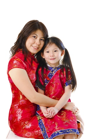 Traditional Chinese Asian mother and her daughter on white background, Good for mother's day Stock Photo - 13557419