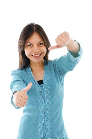 Pretty female Asian model smiling in traditional kebaya tress photo
