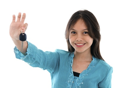 sell car: malay girl holding a car key wearing a traditional dress