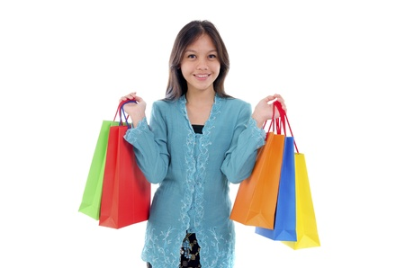 Woman in tradition Kebaya holding colorful shopping bag.  photo
