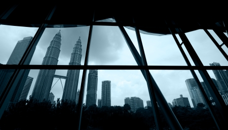 kuala lumpur ,storm is coming view from a framed window photo