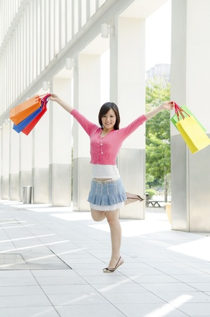 Beautiful shopping woman happy holding shopping bags.  photo
