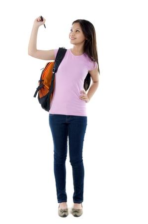 mixed race: mixed race young schoolcollege girl writing Stock Photo